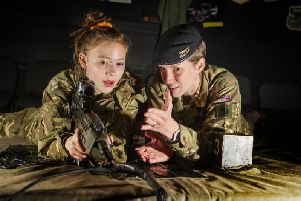 Sgt Claire Norton of trhe Queen's Own Yeomanrywith Courtney Tompkins who attends John Smeaton High School in Leeds. 'TheBritish Army soldiers from across the North have invited students of Clifton School (Rotherham) and John Smeaton School (Leeds) to a fun-filled supercamp at Queen Elizabeth Barracks in  Strensall, York. Pic: Tony Johnson