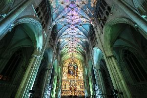 A woman looks on as an art installation is projected on to the interior of York Minster ahead of their Northern Lights opening. 'PA Photo.