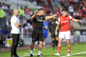 Rotherham United assistant manager Richie Barker, centre, with boss Paul Warne, left.