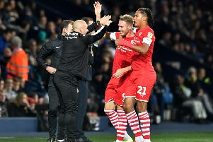 Uniified: Caretaker manager Adam Murray, front left, celebrates with Cauley Woodrow, front right, after his second goal in the creditable 2-2 draw at West Brom last month. (Picture: PA)