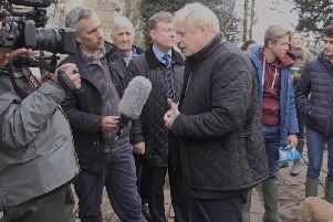 Boris Johnson speaks to the press on a visit to flood-hit parts of Yorkshire. Photo: PA