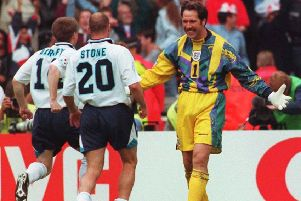 Yorkshireman David Seaman is congratulated by his team-mates Steve Stone and Nick Barmby after saving in the penalty shoot-out to decide the Euro 96 quarter-final clash against Spain, at Wembley. Picture: Adam Butler/PA Wire.