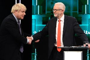 Boris Johnson and Jeremy Corbyn's awkward handshake after being challenged to work together to restore trust in politics.