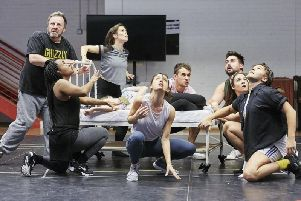 The company in rehearsal for The Wizard of Oz at Leeds Playhouse.