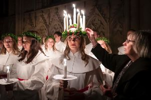 The atmospheric Swedish service is a celebration of St Lucy, a Sicilian girl martyred for her Christian faith in the fourth century. Photo credit: Danny Lawson/PA Wire