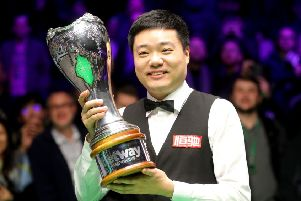 Ding Junhui celebrates with the trophy.