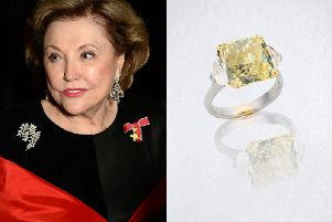Barbara Taylor Bradford wearing the chandelier diamond earrings, and the fancy yellow diamond ring, which sold in auction at Bonhams London. Credit: Bonhams