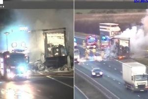 Fire crews battle a blaze in a lorry load of batteries. Photo: Highways England