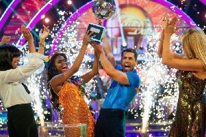 Kelvin Fletcher with Oti Mabuse after the actor won the Glitterball trophy. PIC: Guy Levy/BBC/PA Wire