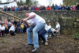 The men's Mother Shipton's team taking part in the annual Boxing Day tug of war tradition.