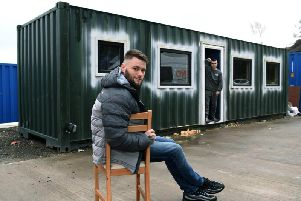 Hayden Lee Jessop with the shipping container, which he is converting into a temporary home for the homeless. Aiden Ramsdale, in the background, is a current service user of Hayden's charity Vulnerable Citizen Support Leeds