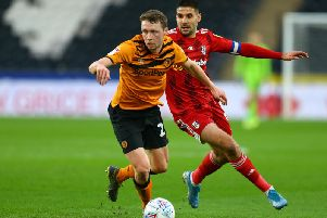 Hull City defender Matthew Pennington gets to the ball ahead of Fulham's Aleksandar Mitrovic during Saturday's Championship clash at the KCOM Stadium. Picture: Getty Images