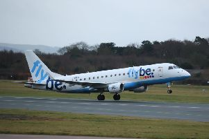 A Flybe flight departs from Manchester Airport. Pic: Pete Byrne/PA Wire