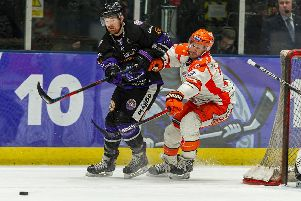 Jonathan Phillips battles for possession at the intu Braehead Arena on Wednesday night. Picture courtesy of Al Goold/EIHL.