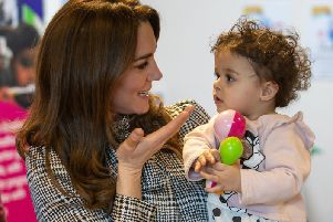 The Duchess of Cambridge with Sorayah Ahmad, 18 months old, during a visit to a Khidmat Centre.