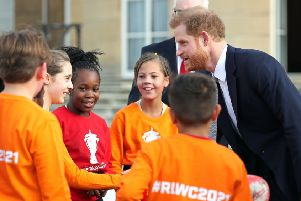 The Duke of Sussex chats with rugby league fans in the Buckingham Palace gardens. Picture: Yui Mok/PA
