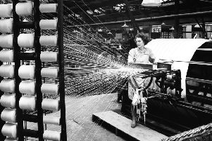 A worker in Salts Mill in the 1950s.