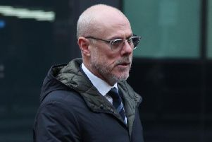 The former assistant head coach of Barnsley FC, Tommy Wright, arrives at Southwark Crown Court.