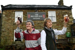 Sisters Rowena Hutchinson and Marguerita at the Red Lion, Langthwaite. Six-month anniversary of floods in the Dales.