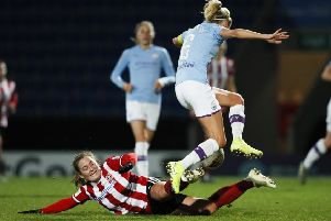 Katie Wilkinson of Sheffield United tackles Steph Houghton of Manchester City during the The FA Women's Continental League Cup match at the Proact Stadium, Chesterfield. (Picture: James Wilson/Sportimage)