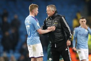 Sheffield United manager Chris Wilder (right) speaks with Manchester City's Kevin De Bruyne after the final whistle during the Premier League match at The Etihad Stadium. Picture: Martin Rickett/PA