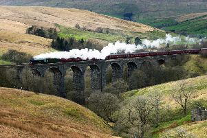 The Flying Scotsman hauling a steam charter train over Ribblehead Viaduct