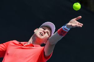 DOWN AND OUT: Kyle Edmund serves against Serbia's Dusan Lajovic on day two of the Australian Open in Melbourne. Picture: Greg Wood/AFPGetty Images