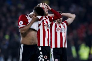 Lys Mousset, Oliver McBurnie and Enda Stevens of Sheffield United look dejected after losing during the Premier League match at Bramall Lane.   Picture: James Wilson/Sportimage