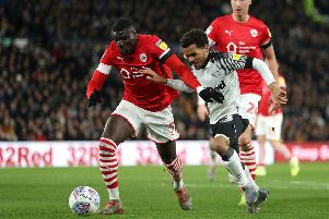 Barnsley's Bambo Diaby (left) battles with Derby County's Duane Holmes earlier this month at Pride Park. Picture: Bradley Collyer/PA