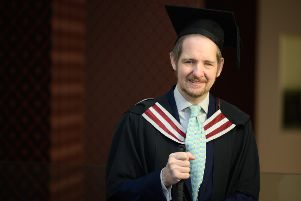 Blind poet Giles Turnbull who has graduated with an MA in creative writing from the same university he graduated from 25 years ago