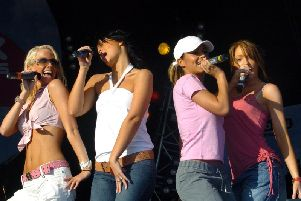 Girls Aloud on stage at Party in the Park.in 2004 Picture: Jonathan Gawthorpe