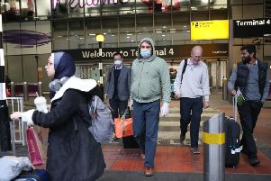 Passengers arrive at Heathrow. PIC: PA