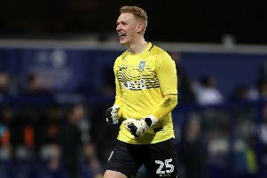 Sheffield Wednesday goalkeeper Cameron Dawson has signed a new long-term contract at the club.