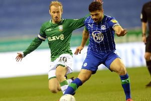Barry Bannan closes down Wigan's Sam Morsy. (Picture: Steve Ellis)