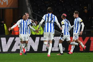 Huddersfield's Karlan Grant celebrates opening the scoring.