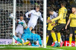 Fighting back: Patrick Bamford, centre, bundles the ball home to give Leeds United hope at the start of the second half against Millwall. (Picture: Bruce Rollinson)