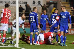 Rotherham captain Richard Wood celebrates his goal on the floor and punches the air.
