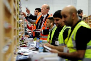 Royal Mail's Stephen Foster helping to sort the incoming mail at Leeds Royal Mail Centre in Stourton. Picture: James Hardisty