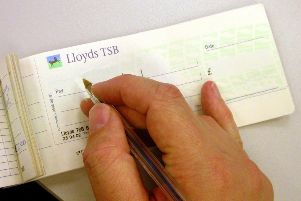 Many consumers value their cheque books Photo: PA Wire