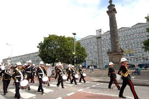 The Band of Her Majesty's Royal Marines pass the William Wilberforce Monument in Hull on Yorkshire Day