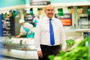 Trevor Strain, chief financial officer of Morrisons, with one of the Amazon Lockers being rolled out across stores