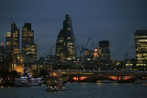 The City of London skyline at dusk, with Blackfriars Bridge in the foreground. Photo: Jonathan Brady/PA Wire