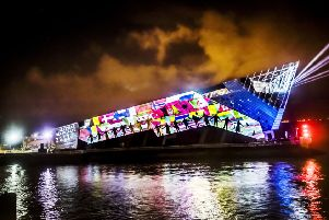 An art installation titled Arrivals and Departures by arts collective 'imitating the dog' is projected onto The Deep in Hull, forming part of the Made in Hull series marking the official opening of its tenure as UK City of Culture.