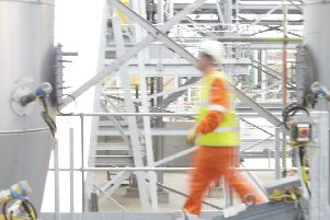 A worker at the Vivergo plant at Hull, which turns surplus what into bioethanol fuel.