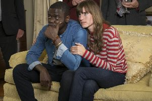 Daniel Kaluuya as Chris and Allison Williams as Rose in Get Out.