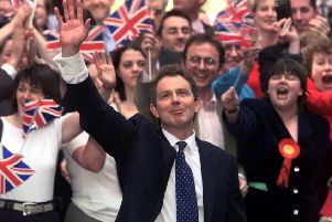 Labour leader Tony Blair waves as he arrives at No.10 Downing Street May 2 in 1997. Blair won the general Election defeating the Conservative John Major in a massive landslide.  Photo by Ian Waldie REUTERS