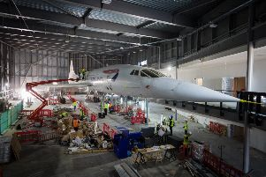 Concorde is unwrapped in its new location at a hanger in Bristol. Picture: SWNS