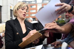 "New Doctor Who star Jodie Whittaker signs autographs as she arrives at ITV Studios in London, after she described becoming the first woman to play the Time Lord as ""incredible and really emotional"". Picture: Victoria Jones/PA Wire"