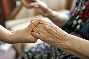 HELPING HANDS: A poll, carried out by Independent Age, finds that nine out of 10 MPs do not believe that the current social care system is fit for purpose. PIC: PA