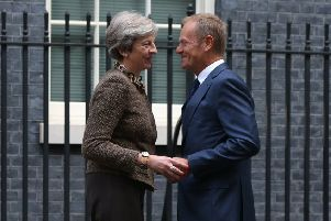 Prime Minister Theresa May greets President of the European Council Donald Tusk at 10 Downing Street.